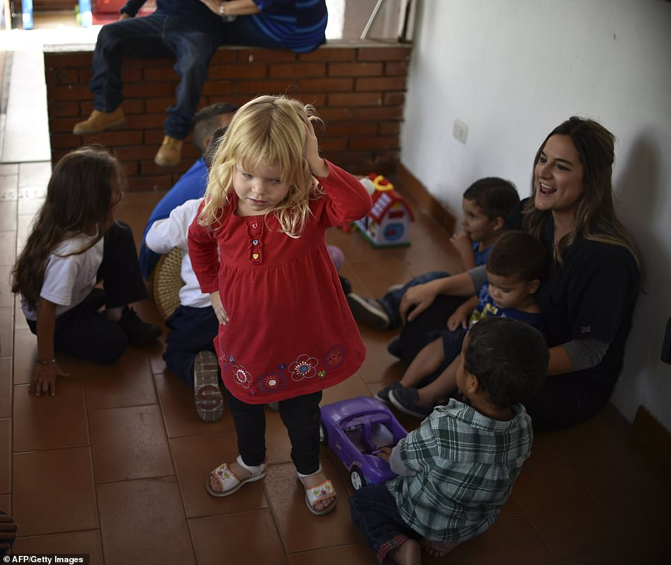 Help: Daniela Olmos, president and founder of the Kapuy Foundation, which supports children in situation of abandonment or with serious health problems, including undernourishment, plays with children in Maracay, Aragua state
